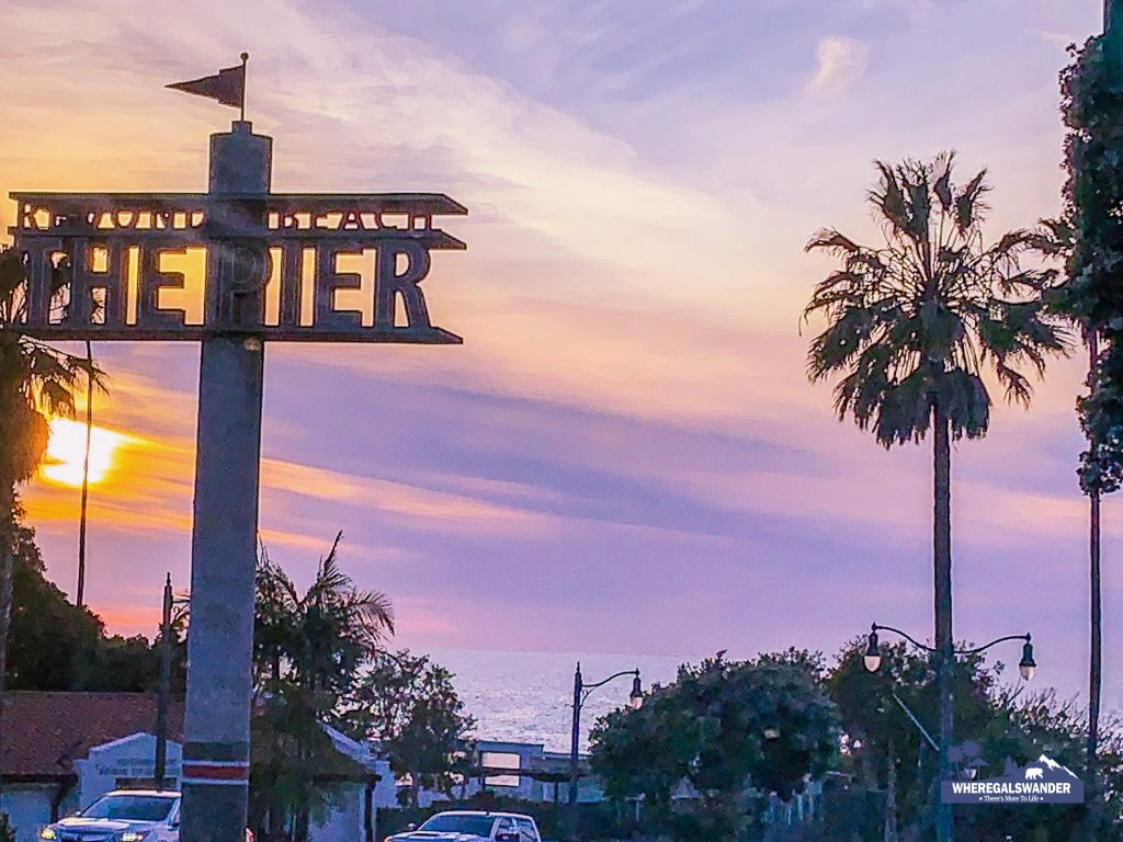 Entering Redondo Beach, sign to the pier against the sunset