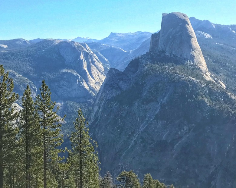 Enjoying sipping my morning coffee coffee at Washburn Point with a view of Half Dome