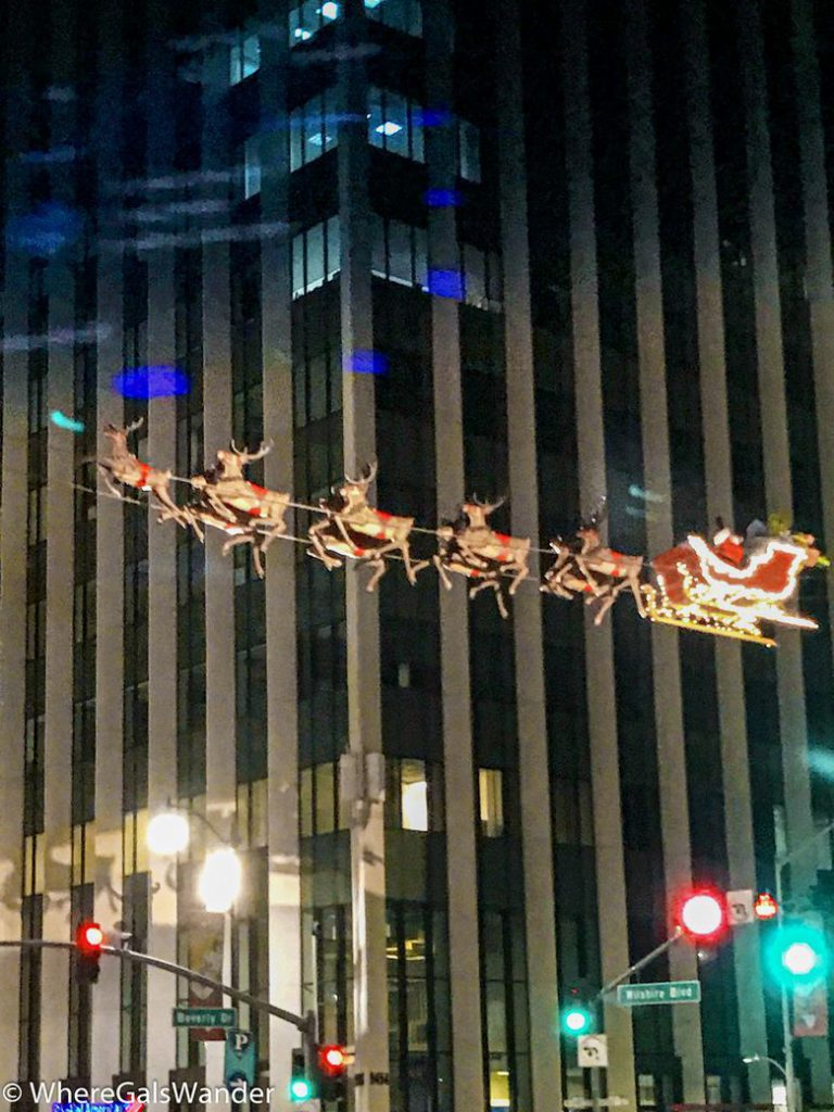Santa flying above Beverly and Wilshire