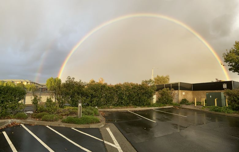 A perfect full arch rainbow and double rainbow outside Los Angeles